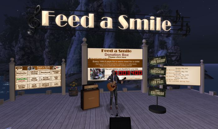 Aminius Writer playing for hungry children at The Lavendar Field for Feed a Smile